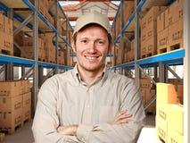 Homme dans l'entrepôt Photographie stock libre de droits