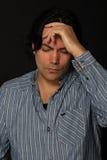 Homme dans l'expression de douleur Photographie stock libre de droits