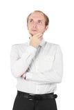 Homme dans la chemise pensant, main sur le menton, d'isolement photo libre de droits