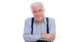 Homme dans la chemise rayée et des bras pliés Photos libres de droits