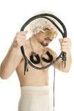 Homme dans la perruque avec le fouet et les menottes photos libres de droits