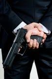 Homme dans le canon de fixation de procès Photographie stock libre de droits