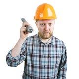 Homme dans le casque avec une lampe-torche image stock