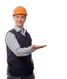 Homme dans le casque orange affichant la paume vide Photo libre de droits