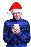 Homme dans le chapeau de Santa avec la cuvette Image libre de droits