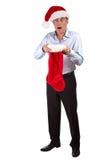 Homme dans le chapeau de Santa choqué au bas de Noël Image stock