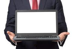 Homme dans le costume avec l'ordinateur portable Photo libre de droits