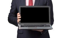 Homme dans le costume avec l'ordinateur portable Photo stock