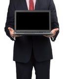 Homme dans le costume avec l'ordinateur portable Images libres de droits