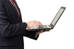 Homme dans le costume avec l'ordinateur portable Photographie stock libre de droits
