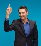 Homme dans le costume avec son doigt  image stock