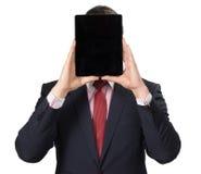 Homme dans le costume avec un PC de comprimé Photo stock
