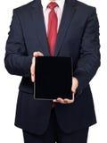 Homme dans le costume avec un PC de comprimé Photographie stock libre de droits