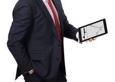 Homme dans le costume avec un PC de comprimé Image stock