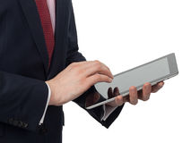 Homme dans le costume avec un PC de comprimé Photographie stock
