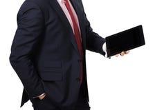 Homme dans le costume avec un PC de comprimé Images stock