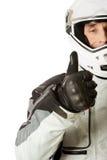 Homme dans le costume de conducteur avec des pouces  Photos stock