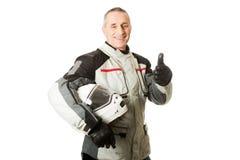 Homme dans le costume de conducteur avec des pouces  Photographie stock