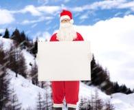 Homme dans le costume du père noël avec le panneau d'affichage Photos libres de droits