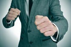 Homme dans le costume prêt à combattre Photos libres de droits