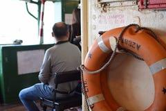 Homme dans le ferry Photo stock