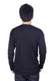 Homme dans le long T-shirt noir de douille d'isolement sur le fond blanc b Photo libre de droits