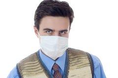 Homme dans le masque au fond blanc Photos libres de droits