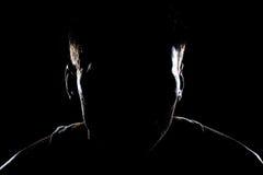 Homme dans le noir Images stock