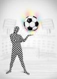 Homme dans le plein ballon de football de holdig de costume de corps Photos libres de droits