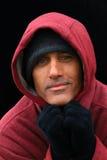 Homme dans le pull molletonné à capuchon Photo libre de droits