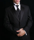 Homme dans le Tux noir photos stock