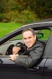 Homme dans le véhicule Images stock