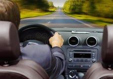 Homme dans le véhicule Photos libres de droits