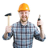 Homme dans un casque avec un marteau et des pinces images stock