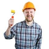 Homme dans un casque avec un rouleau de peinture images libres de droits