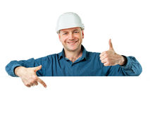 Homme dans un casque de construction Photographie stock libre de droits