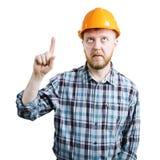 Homme dans un casque montrant son index vers le haut photos stock