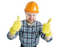 Homme dans un casque orange et des gants de construction images stock