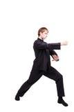 Homme dans un kung-fu de pratique de kimono Photographie stock