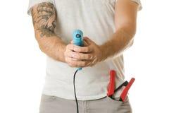 Homme dans une poche construisant des outils photographie stock