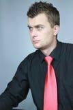 Homme dans une relation étroite rouge Photographie stock libre de droits