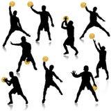 Homme de basket-ball dans le positionnement de silhouette d'action Image libre de droits