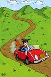Homme de carton conduisant son rouge sportscar Image stock