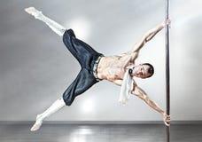 Homme de danse de Pôle photographie stock
