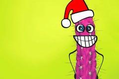 Homme de hippie de cactus avec le chapeau de Santa Concept tropical de Noël Art minimal d'amusement photographie stock
