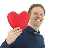 Homme de jour de valentines avec un coeur dans sa main Images stock
