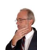 Homme de Moyen Âge avec la main sur le menton Images stock
