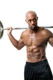Homme de muscle faisant des postures accroupies image libre de droits