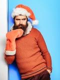 Homme de Noël avec le bas décoratif images stock