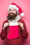 Homme de Noël avec le bas décoratif photographie stock libre de droits